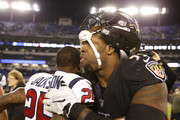 Outside Linebacker Terrell Suggs #55 of the Baltimore Ravens hugs cornerback Kareem Jackson #25 of the Houston Texans after the Ravens win 23-16 at M&T Bank Stadium on November 27, 2017 in Baltimore, Maryland.