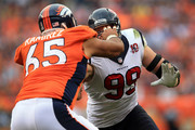 Defensive end J.J. Watt #99 of the Houston Texans rushes the line of scrimage against guard Manny Ramirez #65 of the Denver Broncos at Sports Authority Field at Mile High on September 23, 2012 in Denver, Colorado. The Texans defeated the Broncos 31-25.