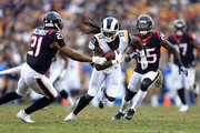 Sammy Watkins #12 of the Los Angeles Rams runs past  Marcus Gilchrist #21 and  Kareem Jackson #25 of the Houston Texans during the second half of game at Los Angeles Memorial Coliseum on November 12, 2017 in Los Angeles, California.