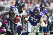 Braxton Miller #13 of the Houston Texans runs with the ball after making a catch in front of Audie Cole #57 of the Minnesota Vikings during the first quarter of the game on October 9, 2016 at US Bank Stadium in Minneapolis, Minnesota.