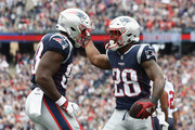 James White #28 of the New England Patriots celebrates with Dwayne Allen #83 after scoring a second quarter touchdown against the Houston Texans at Gillette Stadium on September 9, 2018 in Foxborough, Massachusetts.