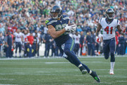 Tight end Jimmy Graham #88 of the Seattle Seahawks scores the winning touchdown to beat the Houston Texans 41-38 at CenturyLink Field on October 29, 2017 in Seattle, Washington.