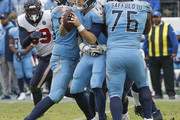 Quarterback Ryan Tannehill #17 of the Tennessee Titans is sacked by the Houston Texans during the second half at Nissan Stadium on December 15, 2019 in Nashville, Tennessee.