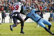 Ryan Tannehill #17 of the Tennessee Titans tries to tackled Whitney Mercilus #59 of the Houston Texans after an interception during the first half at Nissan Stadium on December 15, 2019 in Nashville, Tennessee.