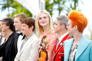 """(L-R) Neil Gaiman, Aj Lewis, Alex Sharp, Elle Fanning, John Cameron Mitchell and Sandy Powell attend the """"How To Talk To Girls At Parties"""" photocall during the 70th annual Cannes Film Festival on May 21, 2017 in Cannes, France."""