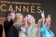 (FromL) British author Neil Gaiman, Australian actress Nicole Kidman, US actress Elle Fanning and British costume designer Sandy Powell pose as they arrive on May 21, 2017 for the screening of the film 'How to talk to Girls at Parties' at the 70th edition of the Cannes Film Festival in Cannes, southern France.  / AFP PHOTO / Valery HACHE