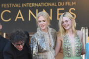 """(Clockwise from top left) Writer Neil Gaiman, actress Nicole Kidman, actors Elle Fanning, Alex Sharp, director John Cameron Mitchell and AJ Lewis attend the """"How To Talk To Girls At Parties"""" screening during the 70th annual Cannes Film Festival at  on May 21, 2017 in Cannes, France."""