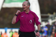 Referee Mike Dean during the Premier League match between Huddersfield Town and Crystal Palace at John Smith's Stadium on March 17, 2018 in Huddersfield, England.