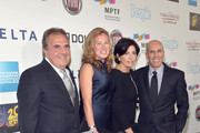 """(L-R) Chairman & Chief Executive Officer of Fox Filmed Entertainment Jim Gianopulos, Ann Gianopulos, Marilyn Katzenberg and Dreamworks Animation CEO Jeffrey Katzenberg attend """"Hugh Jackman... One Night Only"""" Benefiting MPTF at Dolby Theatre on October 12, 2013 in Hollywood, California."""