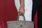 Franziska van Almsick carries a handbag at the Hugo Boss Show during the Mercedes Benz Fashion Week Autumn/Winter 2011 at Neue Nationalgalerie on January 20, 2011 in Berlin, Germany.