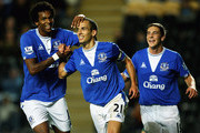 Leon Osman of Everton is congratulated on his goal by Jo and Dan Gosling during the Carling Cup Third Round match between Hull City and Everton at the KC Stadium on September 23, 2009 in Hull, England.