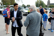Hatem Ben Arfa of Hull City gestures to fans after signing autographs for fans before the Barclays Premier League match between Hull City and Manchester City at KC Stadium on September 27, 2014 in Hull, England.