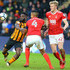 Nouha Dicko Photos - Hull City's Nouha Dicko lines up a shot on goal while Nottingham Forest's Michael Mancienne and Joe Worrall challenge for the ball during the Emirates FA Cup Fourth Round match between Hull City and Nottingham Forest at KCOM Stadium on January 27, 2018 in Hull, England. - Hull City v Nottingham Forest - The Emirates FA Cup Fourth Round