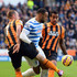Matt Philips of QPR battles with David Meyler (L) and Tom Huddlestone of Hull City during the Barclays Premier League match between Hull City and Queens Park Rangers at KC Stadium on February 21, 2015 in Hull, England.