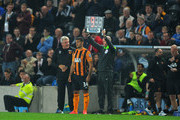 New Hull City signing Hatem Ben Arfa gets some advice from manager Steve Bruce before coming on for his debut during the Barclays Premier League match between Hull City and West Ham United at KC Stadium on September 15, 2014 in Hull, England.