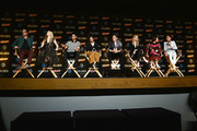 (L-R) Executive producers Josh Schwartz and Stephanie Savage and actors Rhenzy Feliz, Lyrica Okano, Gregg Sulkin, Virginia Gardner, Ariela Barer, and Allegra Acosta participate in Hulu's Runaways panel at New York Comic Con at Jacob Javits Center on October 6, 2017 in New York City.