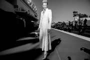 """Image has been converted to black and white.) Tilda Swinton walks the red carpet ahead of the movie """"The Human Voice"""" and """"Quo Vadis, Aida?"""" at the 77th Venice Film Festival at  on September 03, 2020 in Venice, Italy."""