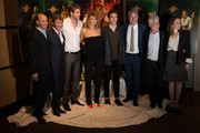 (L-R) Producer Jon Kilik, Lionsgate Films Co-Chairman Patrick Wachsberger, actor Alan Ritchson, actress Jennifer Lawrence, actor Sam Claflin and director Francis Lawrence, Lionsgate Films Co-Chairman Rob Friedman and producer Nina Jacobson pose at the 'The Hunger Games: Catching Fire' photo call during The 66th Annual Cannes Film Festival at Nespresso Beach on May 18, 2013 in Cannes, France.