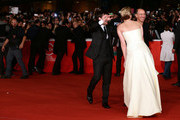 Actors Josh Hutcherson (L), Jennifer Lawrence (C) and producer Jon Kilik attend the 'The Hunger Games: Catching Fire' Premiere during The 8th Rome Film Festival at Auditorium Parco Della Musica on November 14, 2013 in Rome, Italy.