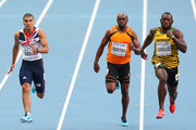 Adam Gemili of Great Britain, Churandy Martina of the Netherlands and Nickel Ashmeade of Jamaica competes in the Men's 200 metres semi finals during Day Seven of the 14th IAAF World Athletics Championships Moscow 2013 at Luzhniki Stadium at Luzhniki Stadium on August 16, 2013 in Moscow, Russia.