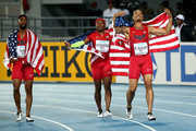 Ryan Bailey, Tyson Gay, and Mike Rodgers of the United States celebrate after winning the final of the menÂ's 4 x 100 metres  on day one of the IAAF World Relays at Thomas Robinson Stadium on May 2, 2015 in Nassau, Bahamas.