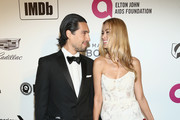 Petra Nemcova (R) and guest attend IMDb LIVE At The Elton John AIDS Foundation Academy Awards® Viewing Party on February 24, 2019 in Los Angeles, California.