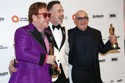 Elton John, David Furnish and Bernie Taupin walk the red carpet at the Elton John AIDS Foundation Academy Awards Viewing Party on February 09, 2020 in Los Angeles, California.