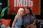 Donatella Versace and Aisha Tyler speak onstage at IMDb LIVE Presented By M&M'S At The Elton John AIDS Foundation Academy Awards Viewing Party on February 09, 2020 in Los Angeles, California.