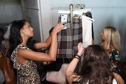 Guests browse clothing racks during The Talks: In Conversation with Tan France and Negin Mirsalehi Presented by Express at Spring Studios on September 05, 2019 in New York City.
