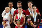 Winner Xue Shen and Hongbo Zhao of China (C), 2nd placed Qing Pang and Jian Tong of China (R) and 3rd placed Aliona Savchenko and Robin Szolkowy of Germany (L) pose for photographs after competing in the Pairs Free Skating on the day three of ISU Grand Prix of Figure Skating Final at Yoyogi National Gymnasium on December 5, 2009 in Tokyo, Japan.