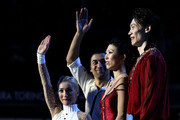 Qing Pang and Jian Tong of China look on as Aliona Savchenko and Robin Szolkowy of Germany wave to the crowd after the Pairs Free Skate during the 2010 ISU World Figure Skating Championships on March 24, 2010 at the Palevela in Turin, Italy.