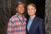 """Russell Simmons and Editor in Chief of Dujour Jason Binn attend the IWC Schaffhausen and DuJour Magazine's Jason Binn's celebration of """"Timeless Portofino"""" during Art Basel Miami Beach at The W Hotel South Beach on December 3, 2014 in Miami, Florida."""