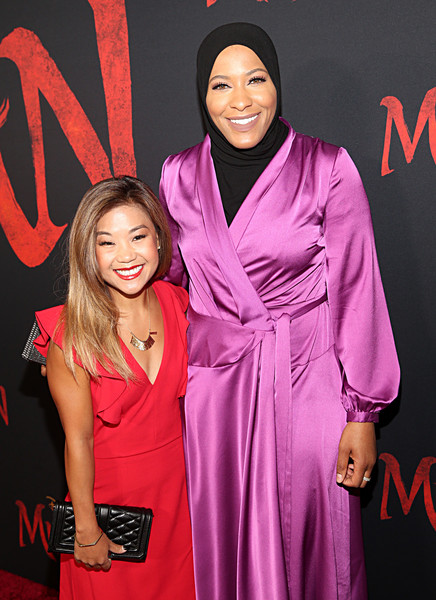 "Los Angeles World Premiere Of Disney's ""Mulan"" [mulan,pink,magenta,fashion,carpet,premiere,event,formal wear,dress,fashion design,red carpet,carpet,scout,ibtihaj muhammad,fashion,red carpet,l-r,bassett,disney,los angeles world premiere,red carpet,celebrity,fashion,pink m,socialite,model,carpet,red,outerwear,beauty.m]"