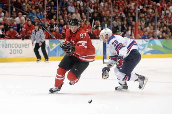 Sidney Crosby (Canada) skates past US ice hockey player