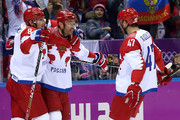 Ilya Kovalchuk #71 of Russia celebrates with teammates Alexander Ovechkin #8 and Alexander Radulov #47 after scoring a first-period goal against Finland during the Men's Ice Hockey Quarterfinal Playoff on Day 12 of the 2014 Sochi Winter Olympics at Bolshoy Ice Dome on February 19, 2014 in Sochi, Russia.