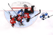 Veli-Matti Savinainen #86 of Finland collides with Ben Scrivens #30 of Canada in the second period during the Men's Play-offs Quarterfinals on day twelve of the PyeongChang 2018 Winter Olympic Games at Gangneung Hockey Centre on February 21, 2018 in Gangneung, South Korea.