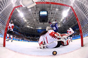 Hilary Knight #21 of the United States scores a power play goal against Shannon Szabados #1 of Canada in the first period during the Women's Gold Medal Game on day thirteen of the PyeongChang 2018 Winter Olympic Games at Gangneung Hockey Centre on February 22, 2018 in Gangneung, South Korea.