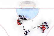 Jamie Benn #22 of Canada shoots and scores against Brooks Orpik #44 and Jonathan Quick #32 of the United States in the second period during the Men's Ice Hockey Semifinal Playoff on Day 14 of the 2014 Sochi Winter Olympics at Bolshoy Ice Dome on February 21, 2014 in Sochi, Russia.