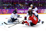 Sidney Crosby #87 of Canada attempts to score against Brooks Orpik #44 and Jonathan Quick #32 of the United States during the Men's Ice Hockey Semifinal Playoff on Day 14 of the 2014 Sochi Winter Olympics at Bolshoy Ice Dome on February 21, 2014 in Sochi, Russia.