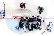 Kimmo Timonen #44 of Finland loses his helmet against Zach Parise #9, Jonathan Quick #32, Brooks Orpik #44 and Ryan McDonagh #27 of the United States in the first period during the Men's Ice Hockey Bronze Medal Game on Day 15 of the 2014 Sochi Winter Olympics at Bolshoy Ice Dome on February 22, 2014 in Sochi, Russia.