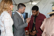 (L-R) Karen Martinez, Juanes and Usher Raymond attend The Inaugural $12 Million Pegasus World Cup Invitational, The World's Richest Thoroughbred Horse Race At Gulfstream Park at Gulfstream Park on January 28, 2017 in Hallandale, Florida.