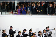 (L-R) Sasha Obama, Malia Obama,first lady Michelle Obama, U.S. President Barack Obama, U.S. Chief of Staff of the Army General Raymond Odierno and U.S. Vice President Joe Biden watch from the reviewing stand as the presidential inaugural parade winds through the nation's capital January 21, 2013 in Washington, DC. Barack Obama was ceremonially sworn in for a second term as President of the United States.