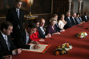 Mark Rutte (2nd-L) signs the Act of Abdication as Queen Beatrix of the Netherlands (5th-L), her son Prince Willem-Alexander of the Netherlands (6th-L) and as his wife Princess Maxima of the Netherlands (7th-L) looks on during the abdication ceremony in the Moseszaal at the Royal Palace on April 30, 2013 in Amsterdam. Queen Beatrix of the Netherlands is abdicating the throne after a 33 year reign and hands the throne to her son Prince Willem-Alexander who will be sworn in later at the Nieuwe Kerk ahead of a joint session of parliament.