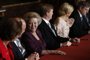 Prince Willem-Alexander of the Netherlands sits alongside his wife Princess Maxima of the Netherlands (2nd-R) during the abdication ceremony of his mother Queen Beatrix of the Netherlands (3rd-L) in the Moseszaal at the Royal Palace on April 30, 2013 in Amsterdam. Queen Beatrix of the Netherlands is abdicating the throne after a 33 year reign and hands the throne to her son Prince Willem-Alexander who will be sworn in later at the Nieuwe Kerk ahead of a joint session of parliament.