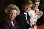 Prince Willem-Alexander of the Netherlands sits alongside his wife Princess Maxima of the Netherlands (R) during the abdication ceremony of his mother Queen Beatrix of the Netherlands (L) in the Moseszaal at the Royal Palace on April 30, 2013 in Amsterdam. Queen Beatrix of the Netherlands is abdicating the throne after a 33 year reign and hands the throne to her son Prince Willem-Alexander who will be sworn in later at the Nieuwe Kerk ahead of a joint session of parliament.