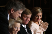 Queen Beatrix of the Netherlands is passed the Act of Abdication as her son Prince Willem-Alexander of the Netherlands watches his wife Princess Maxima of the Netherlands (R) during the abdication ceremony in the Moseszaal at the Royal Palace on April 30, 2013 in Amsterdam. Queen Beatrix of the Netherlands is abdicating the throne after a 33 year reign and hands the throne to her son Prince Willem-Alexander who will be sworn in later at the Nieuwe Kerk ahead of a joint session of parliament.