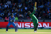 Shoaib Malik of Pakistan hits out for six during the ICC Champions Trophy match between India and Pakistan at Edgbaston on June 4, 2017 in Birmingham, England.
