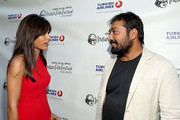 "Actress Freida Pinto and director Anurag Kashyap attend the Indian Film Festival of Los Angeles (IFFLA) Opening Night Gala for ""Gangs Of Wasseypur"" at ArcLight Cinemas on April 9, 2013 in Hollywood, California."