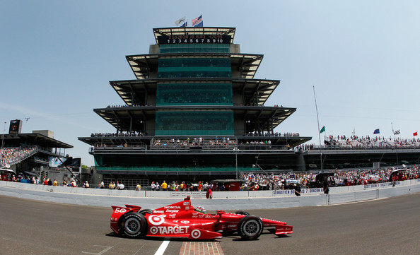 Dario Franchitti of England, driver of the #50 Target Chip Ganassi Racing Honda, races across the yard of bricks during the IZOD IndyCar Series 96th running of the Indianpolis 500 mile race at the Indianapolis Motor Speedway on May 27, 2012 in Indianapolis, Indiana.
