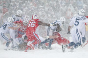 Frank Gore #23 of the Indianapolis Colts runs the ball as Kyle Williams #95 of the Buffalo Bills attempts to tackle him during the second quarter on December 10, 2017 at New Era Field in Orchard Park, New York.